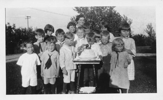 Morris Odvarka w birthday cake Lena Platz Odvarka in back